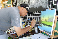 Artist Byrnes paints during the 6th Annual Pico Festival and Classic Car Show at Virginia Avenue Park on Sunday, October 2, 2011