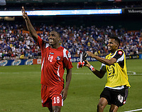 Luis Tejada (18) of Panama celebrates converting the winning penalty kick with teammate Luis Mejia (12) during the game at RFK Stadium in Washington, DC.  Panama defeated El Salvador on penalty kicks, 5-3, after tying, 1-1,  in regulation time.