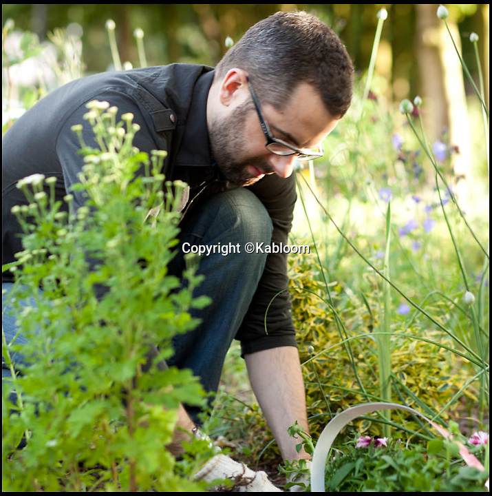 BNPS.co.uk (01202 558833)<br /> Pic: Kabloom/BNPS<br /> <br /> ***Please Use Full Byline***<br /> <br /> A seedbomb being planted. <br /> <br /> A gardening enthusiast has come up with an innovative way to spruce up abandoned areas - with 'bombs' full of wildflower seeds.<br /> <br /> The bombs are made from recycled paper and peat-free compost and shaped to look like a grenade.<br /> <br /> They are filled with a variety of seeds including poppies, marigolds, clover, cornflower, forget-me-not, thyme, and basil.<br /> <br /> They can be tossed anywhere and will naturally disentegrate into the ground over time, dispersing the seeds.