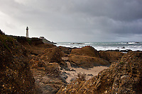 The lighthouse at Pigeon Point State Historic Park viewed from the rocky shore just to its north.
