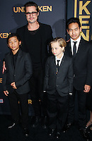 HOLLYWOOD, LOS ANGELES, CA, USA - DECEMBER 15: Brad Pitt; Pax Thien Jolie-Pitt, Shiloh Nouvel Jolie-Pitt, Maddox Jolie-Pitt arrive at the Los Angeles Premiere Of Universal Pictures' 'Unbroken' held at the Dolby Theatre on December 15, 2014 in Hollywood, Los Angeles, California, United States. (Photo by Celebrity Monitor)