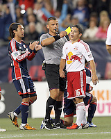 New York Red Bulls defender Connor Lade (16) receives a second yellow card, a red card ejection. Despite a red-card man advantage, in a Major League Soccer (MLS) match, the New England Revolution tied New York Red Bulls, 1-1, at Gillette Stadium on September 22, 2012.