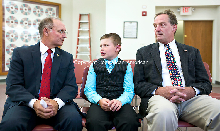 "Harwinton, CT- 30 September 2015-093015CM13- Chad Edmond, 8, of Harwinton, talks with State Senator, Henri Martin (R-36), left, and State Representative John Piscopo (R-76) at the Harwinton Town Hall on Wednesday.  Edmond was named ""Selectman of the Day"" after participating in the summer program, ""Readers are Leaders"".     Christopher Massa Republican-American"