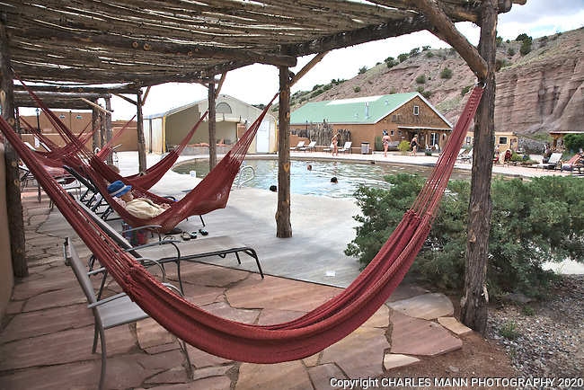 A ramada, or shade structure, provides a spot for visitors to relax in a hammock at the Ojo Caliente Mineral Springs Resort and Spa in northern New Mexico near the village of Ojo Caliente.