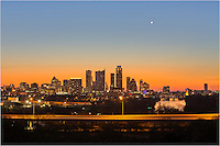 A warm glow lights up the horizon on a cold February morning. This image from the Zilker Park Clubhouse shows the Austin skyline emerging from the night as first light shines in the distance.