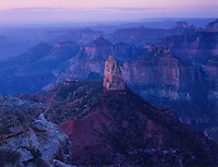 749220132 faint dawn lights up mount hayden and the canyon at point imperial on the north rim of grand canyon national park in arizona