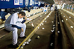 Seattle Mariners starter Felix Hernandez sits alone in the team dugout after being relieved in the eight inning against the Oakland Athletics at Safeco Field in Seattle April 27, 2008. Hernandez struck out 10 batters in the Mariners 2-4 loss to the Athletics. Jim Bryant Photo