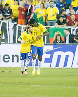 Brazil midfielder Bernard (20) and Brazil forward Jo (21) celebrate a Brazil goal.  In an International friendly match Brazil defeated Portugal, 3-1, at Gillette Stadium on Sep 10, 2013.