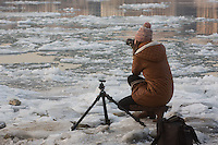 Photographer takes pictures of the floating ice that is seen on river Danube in front of the Hungarian Parliament building in Budapest, Hungary on January 11, 2017. ATTILA VOLGYI