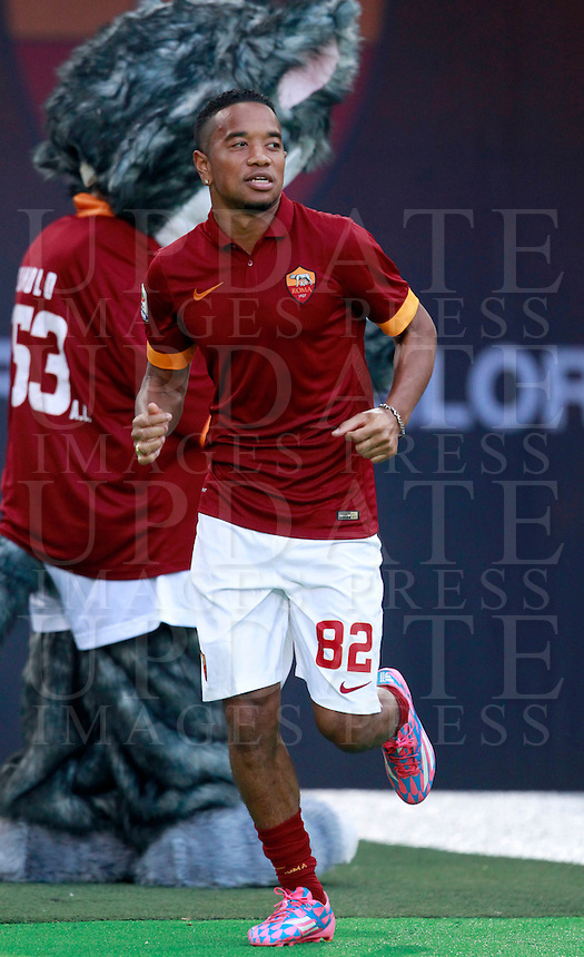 Calcio, amichevole Roma vs Fenerbahce. Roma, stadio Olimpico, 19 agosto 2014.<br /> Roma defender Urby Emanuelson, of the Netherlands, arrives for the team's presentation, prior to the friendly match between AS Roma and Fenerbahce at Rome's Olympic stadium, 19 August 2014.<br /> UPDATE IMAGES PRESS/Isabella Bonotto