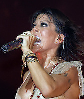 """Mexican singer sings a song of her new album """"Indeleble"""" (Indelible) during a concert at the Mexico City's Hard Rock Cafe, March 30, 2006. Photo by © Javier Rodriguez"""