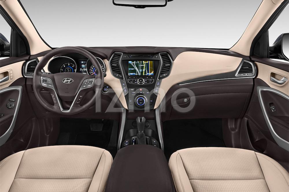 Stock photo of straight dashboard view of a 2015 Hyundai Grand Santa Fe Executive 5 Door