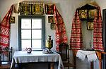 Stock photo of an Ancient Ukrainian country house kitchen interior decorated with Ukrainian folk patterns and icons Eastern Europe Ukraine Pirogovo Ukrainian national folk art museum near Kiev Horizontal 2007