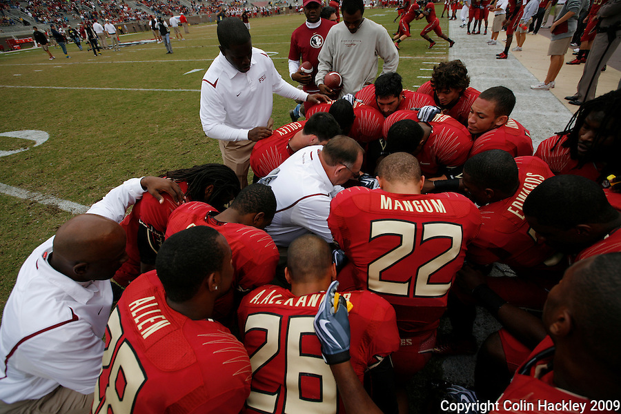 TALLAHASSEE, FL 11/21/09-FSU-MARY FB09 CH24-Florida State Defensive Coordinator Mickey Andrew's, center, huddles with his team prior to the Maryland game Saturday at Doak Campbell Stadium in Tallahassee. .COLIN HACKLEY PHOTO