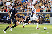 Marko Perovic (29) of the New England Revolution is trailed by Andrew Jacobson (8) of the Philadelphia Union. The Philadelphia Union and the New England Revolution  played to a 1-1 tie during a Major League Soccer (MLS) match at PPL Park in Chester, PA, on July 31, 2010.