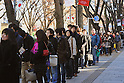 December 27, 2011, Tokyo, Japan - Braving the winter chill, Tokyoites wait in line to grab a bite at Wendys hamburgers as the American fast-food restaurant reopens in Tokyos bustling Omotesando area on Tuesday, December 27, 2011. In December 2009, Wendys did not renew its franchise agreement with its former franchisee for Japan, resulting in the closure of 71 restaurants. Wendys and Higa Industries, a successful food importer and distributor based in Tokyo, signed a joint venture agreement to develop and operate Wendys restaurants in Japan. Wendys Japan plans to open 100 stores in the next five years. (Photo by Natsuki Sakai/AFLO) [3615] -mis-