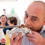 WATERBURY, CT. 06 May 2010-050610SV05--Emilio Theodoratos of Southington enjoys a Gyro at the 38th annual Greek Festival held at the Holy Trinity Greek Church in Waterbury Thursday.  Steven Valenti Republican-American