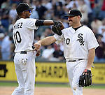 CHICAGO - SEPTEMBER 17:  Alexei Ramirez #10 and Kevin Youkilis #20 of the Chicago White Sox playfully jab at each other during the game against the Detroit Tigers on September 17, 2012 at U.S. Cellular Field in Chicago, Illinois.  The White Sox defeated the Tigers 5-4.  ((Photo by Ron Vesely)  Subject:  Alexei Ramirez; Kevin Youkilis