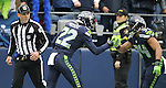 Seattle Seahawks running back Thomas Rawls (34), bumps hands with Seattle Seahawks running back C.J. Prosise (22) after Prosise rushed for a 73-yard touchdown against the Philadelphia Eagles, at CenturyLink Field in Seattle, Washington on November 20, 2016.  Seahawks beat the Eagles 26-15.  ©2016. Jim Bryant Photo. All Rights Reserved.