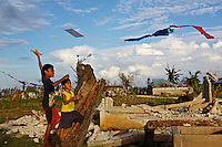 Kids playing with their kites in what looks like a war zone after Typhoon Yolanda passed by. It's amazing to see all the kids still playing and happy.