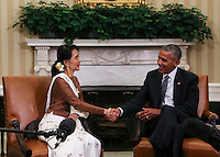 United States President Barack Obama shakes hands with State Counsellor Aung San Suu Kyi of Myanmar (Burma) in the Oval Office of the White House on September 14, 2016 in Washington, DC. <br /> Credit: Aude Guerrucci / Pool via CNP /MediaPunch