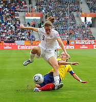 Heather O Reilly (l) of team USA and Natalia Gaitan of team Columbia during the FIFA Women's World Cup at the FIFA Stadium in Sinsheim, Germany on July 2nd, 2011.