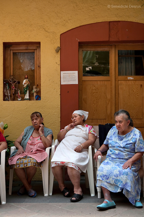 Residents of Casa Xochiquetzal attend a weekly meeting at the shelter in Mexico City, Mexico on May 24, 2009. Community life and participation is promoted among residents by means of easy-to-follow rules. Casa Xochiquetzal is a shelter for elderly sex workers in Mexico City. It gives the women refuge, food, health services, a space to learn about their human rights and courses to help them rediscover their self-confidence and deal with traumatic aspects of their lives. Casa Xochiquetzal provides a space to age with dignity for a group of vulnerable women who are often invisible to society at large. It is the only such shelter existing in Latin America. Photo by Bénédicte Desrus