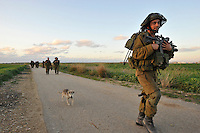 Israeli infantry soldiers (followed by a dog) on the march, moments after withdrawing from the Gaza strip. Israeli forces began an air offensive against Hamas in Gaza on 27/12/2008, which quickly escalated into an offensive by land, sea and air, in retaliation against Palestinian rockets fired into Israel. They ended their campaign after 22 days of fighting.