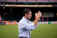 New England Revolution head coach Jay Heaps calls his team to his before a Major League Soccer game at RFK Stadium in Washington, DC.  New England defeated D.C. United, 2-1.
