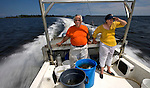 With buckets full of sea creatures, Jack and Anne Rudloe head back to their Gulf Specimen Marine Lab in Panacea, Florida after a secimen collecting trip in the Gulf of Mexico May 27, 2009.  (Mark Wallheiser/TallahasseeStock.com)