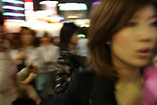 Busy street outside Shinjuku station on a friday evening, Shinjuku, Tokyo, Japan.