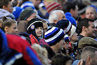 A young Bath supporter in the crowd looks on. European Rugby Champions Cup match, between Bath Rugby and RC Toulon on January 23, 2016 at the Recreation Ground in Bath, England. Photo by: Patrick Khachfe / Onside Images