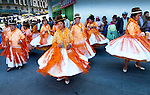 Dancing cholitas dressed in the traditional indigenous Aymaran clothing of bowler hats, mantas or shawls, and pollera dresses, celebrate Bolivian Independence Day, and Bolivia's patron saint, the Virgin Mary, in Plaza San Francisco, La Paz, Bolivia.