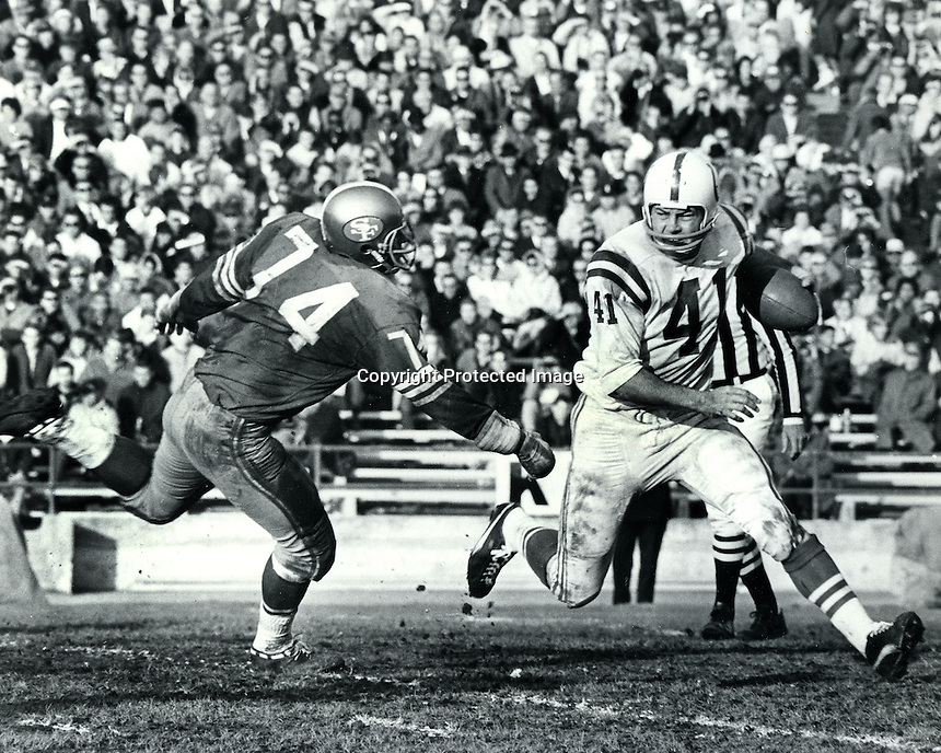Baltimore Colts Tom Matte chased by San Francisco 49ers Clark Miller, NFL game at Kezar Statium in San Francisco. (1966 photo by Ron Riesterer/photoshelter.<br />