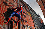 "Street performer Justin ""Spiderman"" Webb clings to a wall in Knoxville, Tenn. (Thunderhead Photography/Wade Payne)"
