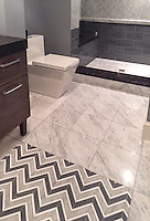 Raj, a stone waterjet mosaic, is  shown in Driftwood, Thassos and Heavenly Cream.<br />