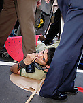 PHILADELPHIA - JUNE 21:  A Philadelphia Police officer holds down an unidentified protester with his foot before arresting the protester during a protest  BIO Conference 2005, the biotechnology industries annual convention June 21, 2005 in Philadelphia, Pennsylvania. The BioDemocracy members demand healthcare for all, environmental justice and sustainable agriculture, and bioweapons and war. (Photo by William Thomas Cain/Getty Images)