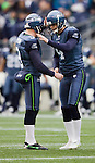 Seattle Kicker Steven Hauschka, right,  kicks one of five field goals  against the Baltimore Ravens at CenturyLink Field in Seattle, Washington on November 13, 2011. The Seahawks beat the Ravens 22-17.  ©2011 Jim Bryant Photo. All Rights Reserved.