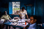 Officials seen doing paper work at a coal mine depot next of Ghanudih in Jharia, outside of Dhanbad in Jharkhand, India.  Photo: Sanjit Das/Panos