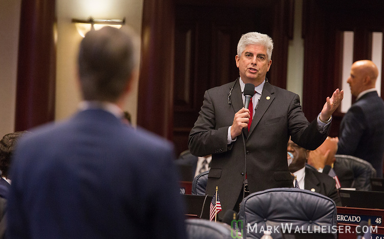 Rep. Julio Gonzalez, right, R-Venice, discusses the drug Fentanyl with bill sponsor Jim Boyd, left, R-Bradenton during Florida House of Representatives floor debate at the Florida Capitol in Tallahassee, Florida.