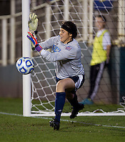 Katelyn Rowland (0) of UCLA saves a penalty kick during the Women's College Cup semifinals at WakeMed Soccer Park in Cary, NC. UCLA advance on penalty kicks after typing Virginia, 1-1 in regulation time.