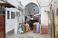 Shops in a narrow street under archways in the medina or old town of Tetouan on the slopes of Jbel Dersa in the Rif Mountains of Northern Morocco. Tetouan was of particular importance in the Islamic period from the 8th century, when it served as the main point of contact between Morocco and Andalusia. After the Reconquest, the town was rebuilt by Andalusian refugees who had been expelled by the Spanish. The medina of Tetouan dates to the 16th century and was declared a UNESCO World Heritage Site in 1997. Picture by Manuel Cohen
