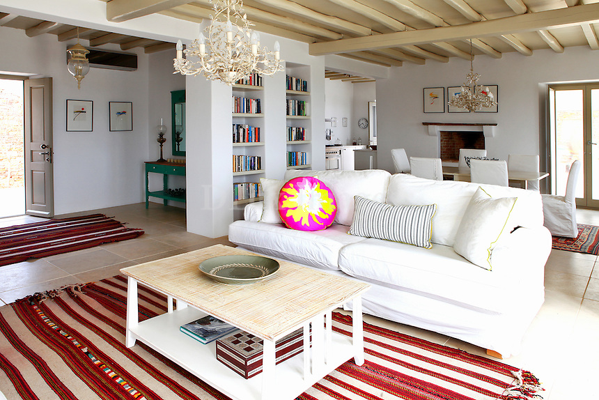 traditional living room..Set in an elevated position with panoramic views that extend from the rolling hills all the way down to the Aegean expanse, Ella II sits on a vast 20 acres estate that has been thoughtfully landscaped to integrate into its natural settings.