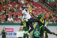 Tampa, FL - September 2, 2016: South Florida Bulls safety Malik Dixon (34) breaks up the pass to Towson Tigers wide receiver Christian Summers (25) during game between Towson and USF at the Raymond James Stadium in Tampa, FL. September 2, 2016.  (Photo by Elliott Brown/Media Images International)