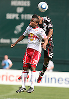 Rodney Wallace #22 of D.C. United up for a header against Dane Ricards #19 of the New York Red Bulls during an MLS match on May 1 2010, at RFK Stadium in Washington D.C.