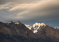 Thomson Mountains with sunrise on Tooth Peak 2061m, Mount Aspiring National Park, Central Otago, New Zealand, NZ