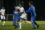 06 December 2014: North Carolina's Andy Craven (10) is defended by UCLA's Grady Howe (4) and Chase Gasper (15). The University of California Los Angeles Bruins hosted the University of North Carolina Tar Heels at Drake Stadium in Los Angeles, California in a 2014 NCAA Division I Men's Soccer Tournament Quarterfinal round match. The game ended in a 3-3 tie after two overtimes. UCLA advanced to the next round by winning the penalty kick shootout 7-6.