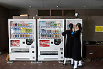 Students buy drinks from a vending machine outside  the dining area of Tokyo Korean High School in Tokyo, Japan on Thursday 07 October, 2010..Photographer: Robert Gilhooly