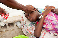 Fonzi Natoma, age 10, is treated for cholera at a clinic on Friday, November 26, 2010 in Cabaret, Haiti.