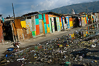 A Haitian woman bathes in a bucket outside sheet-metal houses in a shanty town close to La Saline market, Port-au-Prince, Haiti, 22 July 2008. Although Latin America (as a whole) is blessed with an abundance of fresh water, having 20% of global water resources in the the Amazon Basin and the highest annual rainfall of any region in the world, an estimated 50-70 million Latin Americans (one-tenth of the continent's population) lack access to safe water and 100 million people have no access to any safe sanitation. Complicated geographical conditions (mainly on the Pacific coast), unregulated industrialization (causing environmental pollution) and massive urban poverty, combined with deep social inequality, have caused a severe water supply shortage in many Latin American regions.